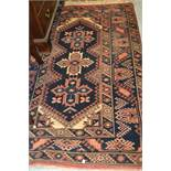 Afghan rug of triple medallion with multiple borders on a blue ground, 72ins x 45ins (at fault),