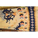 Kelim carpet of geometric design on beige ground, approximately 12ft x 9ft, together with another