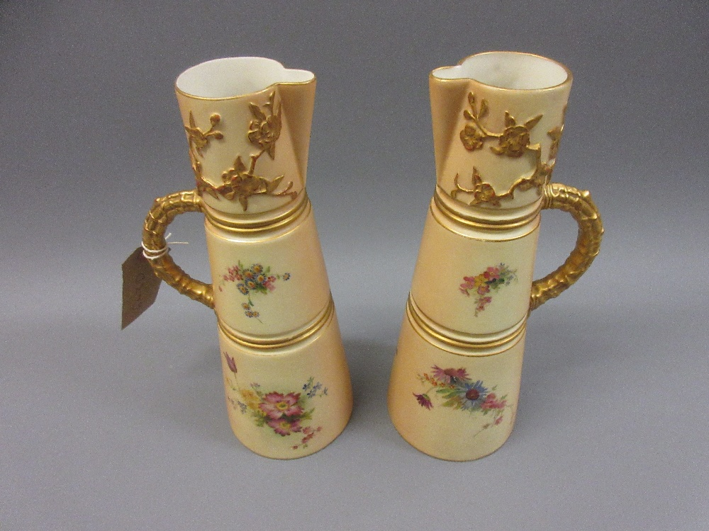 Lot 643D - Pair of Worcester blush ivory jug vases in japanesque style painted with flowers, 10.25ins high