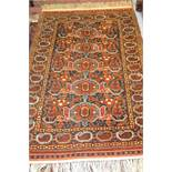 Mid 20th Century Shirvan design rug of five center geometric medallions with multiple borders on a