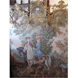 Brass framed floor standing machine woven tapestry of figures on horseback mounted with gilt metal