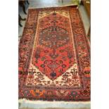 Hamadan rug with a lobed medallion and all-over herati design on a rose ground with ivory corner