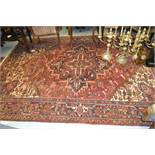 Heriz carpet having medallion and all-over floral design with borders on a wine ground, 10ft x 8ft