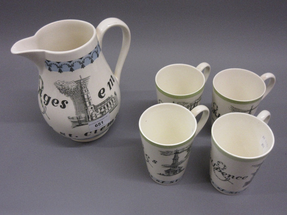 Lot 651 - Wedgwood for Liberty, a jug and four matching mugs, decorated with oranges and lemons design by