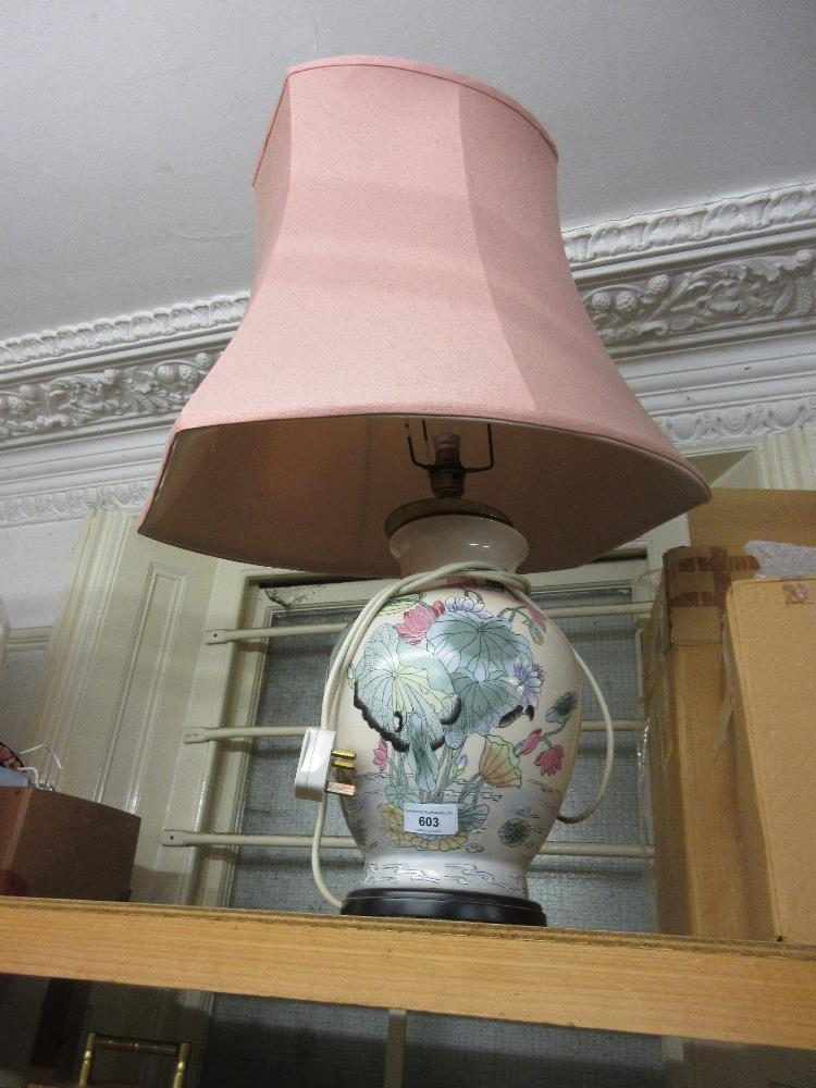 Lot 603 - Modern Chinese style baluster form table lamp base on ebonised plinth with pink shade