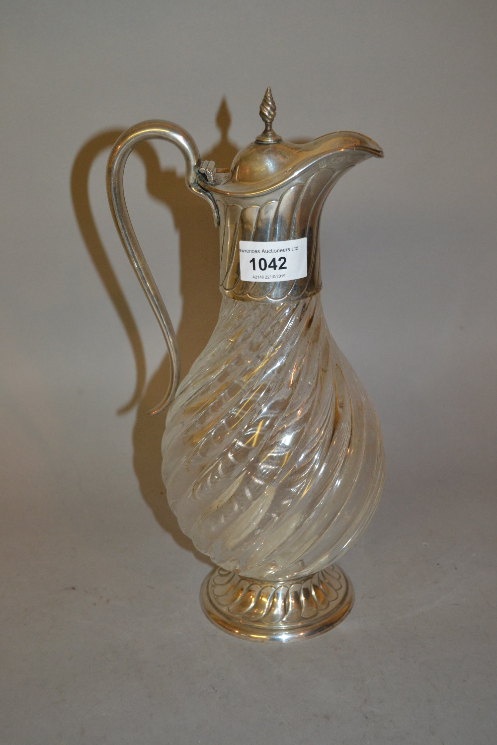 Lot 1042 - London silver mounted claret jug with a spiral fluted body, hinged lid and scroll handle