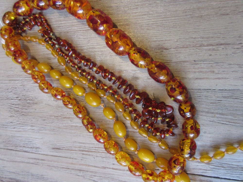 Lot 1094 - Small quantity of various amber coloured bead necklaces