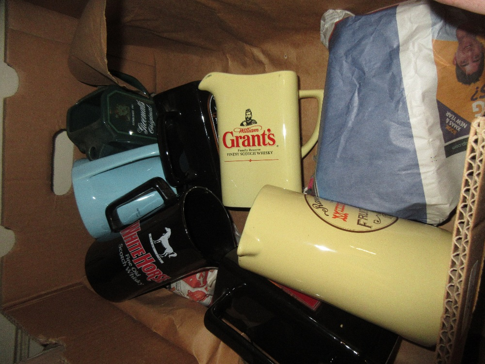 Lot 756 - Box containing a quantity of various advertising jugs including Johnny Walker, White Horse etc