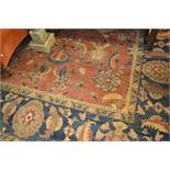 Agra carpet of all-over floral design on a burgundy ground with multiple borders, 116ins x 160ins (