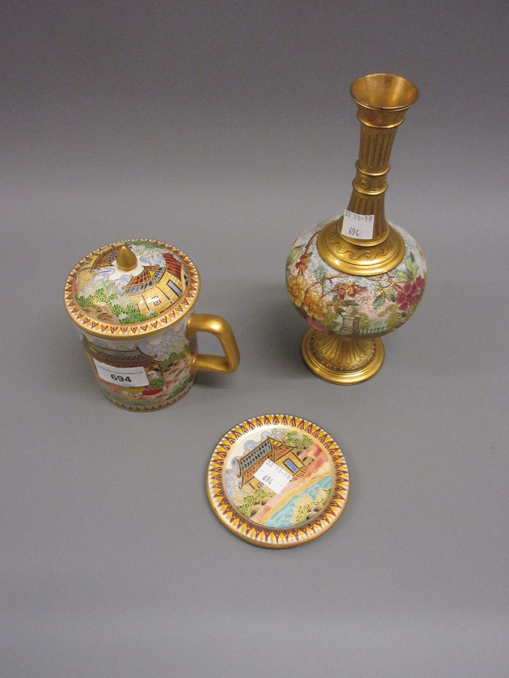 Lot 694 - Floral decorated stoneware and gilt metal mounted pedestal vase and a Thai covered cup and saucer