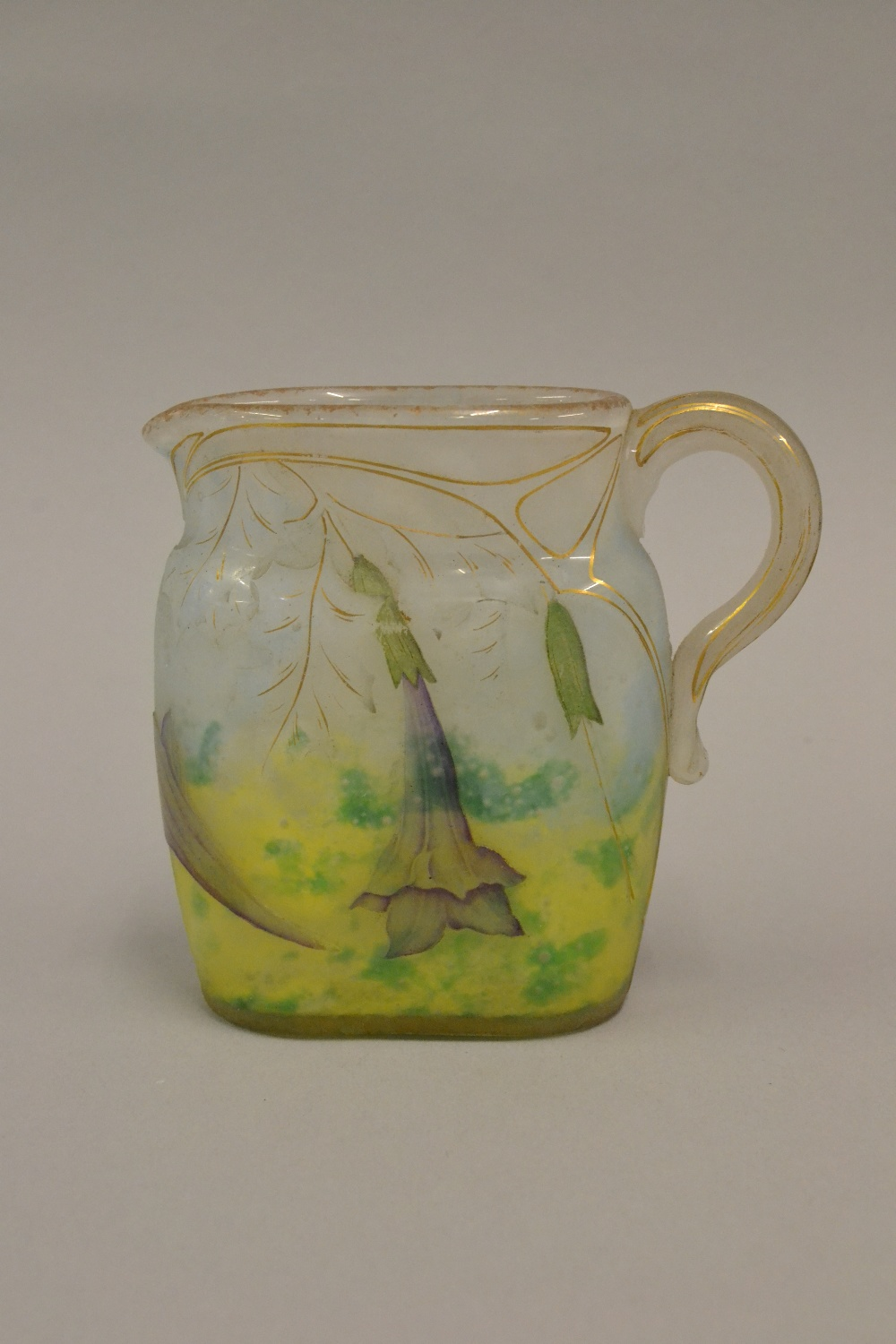 Lot 721 - Daum Nancy cameo glass miniature jug of oval form, carved in shallow relief with trailing flowers,