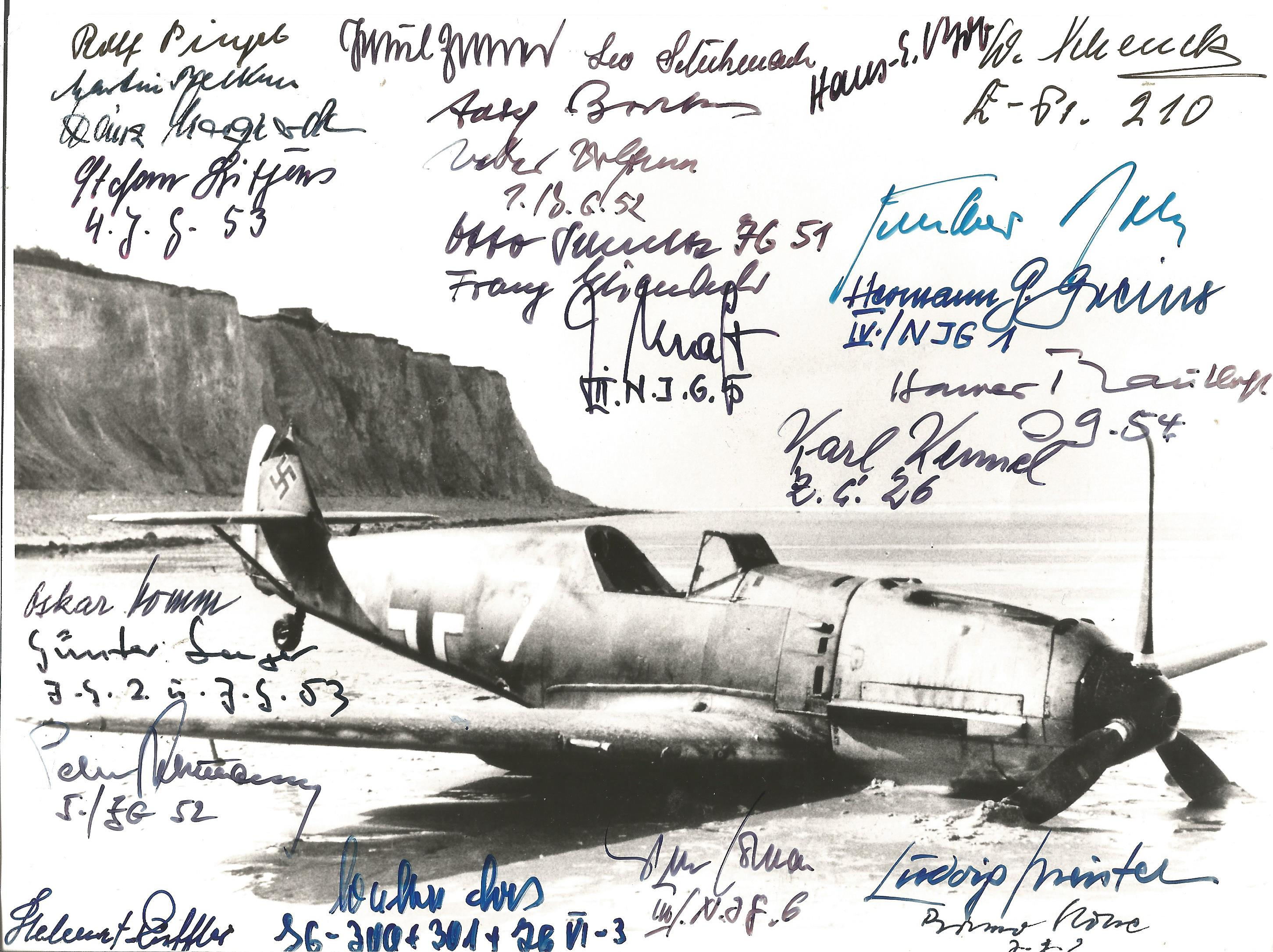 Lot 36 - World War Two rare 8x10 b/w photo signed by 25, Luftwaffe Fighter pilots signatures include Rolf