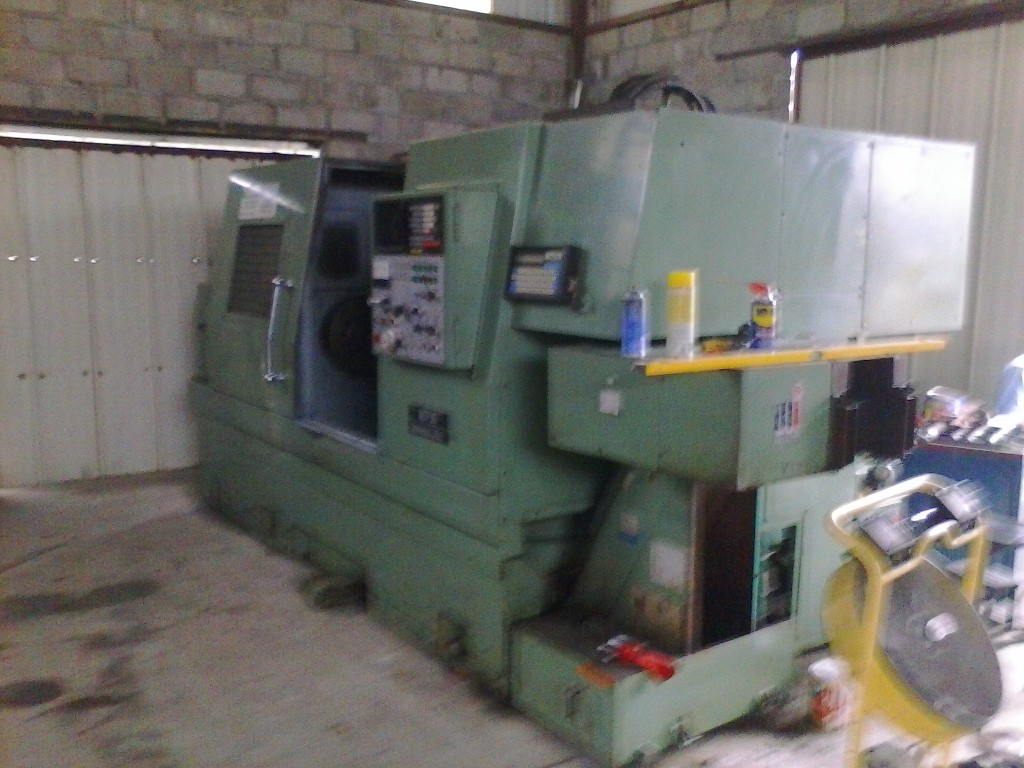 "Lot 44 - NISSAN MACHINE CO. MDL. 3010 UNIVERSAL 2-AXIS CNC LATHE, Fanuc System 6T CNC control, 17"" x 46.2"","