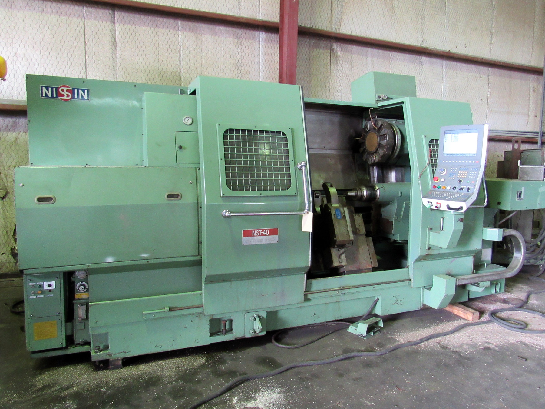 "Lot 52 - NISSIN MDL. NST-40/125 CNC LATHE, rewired & retrofitted in 2010, NCT CNC control, 26"" sw. over"