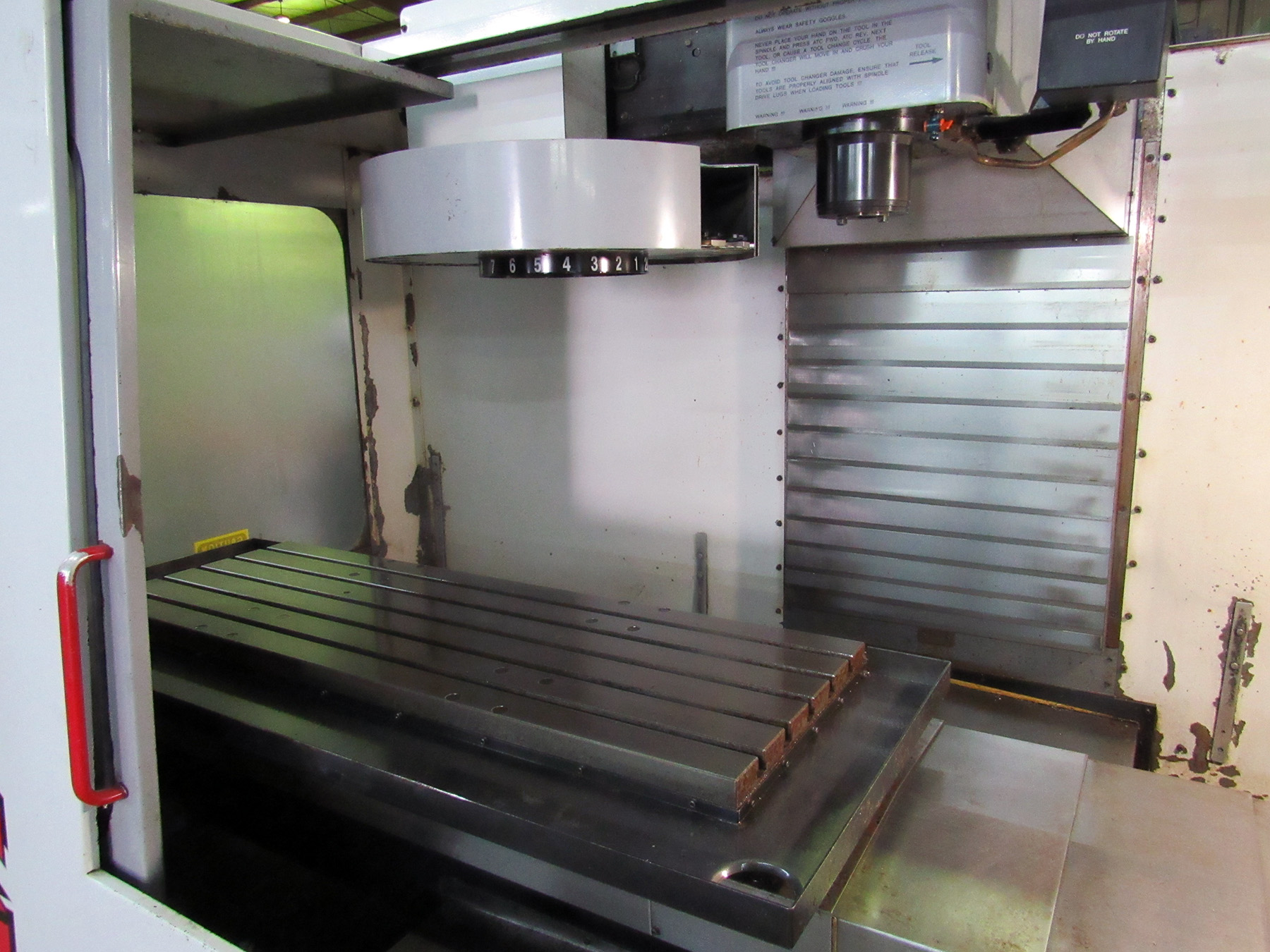 "Lot 25 - HAAS MDL. VF-4 CNC VERTICAL MACHINING CENTER, new 1997, Haas CNC control, 18"" x 52"" table, 50"" X-"