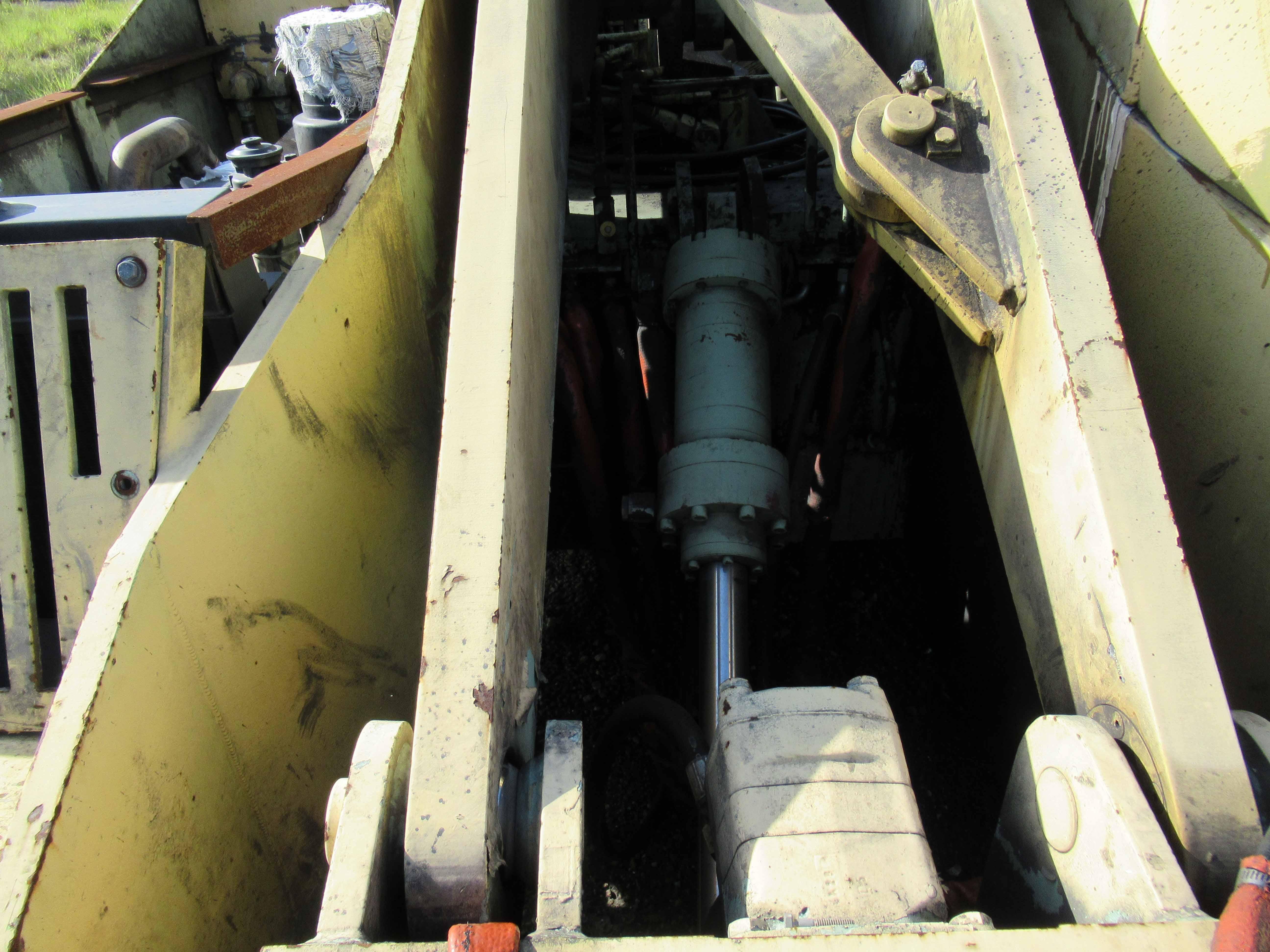 Lot 24 - DANGO 3,000 LB. CAP. FORGING MANIPULATOR, lift & rotate controls. Steel toe shoes, ear plugs and