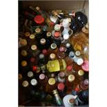 Box of miniature alcohol bottles, all full