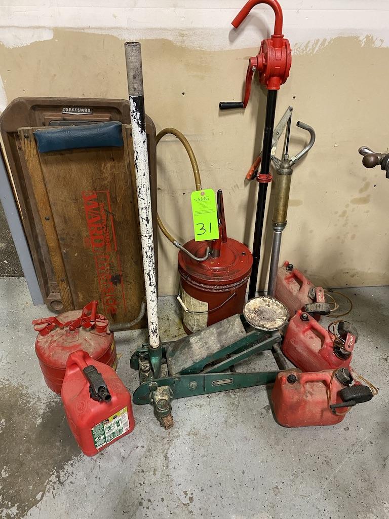 Lot 31 - lot of misc gas cans, barrel pumps hyd, jack, creeper cart