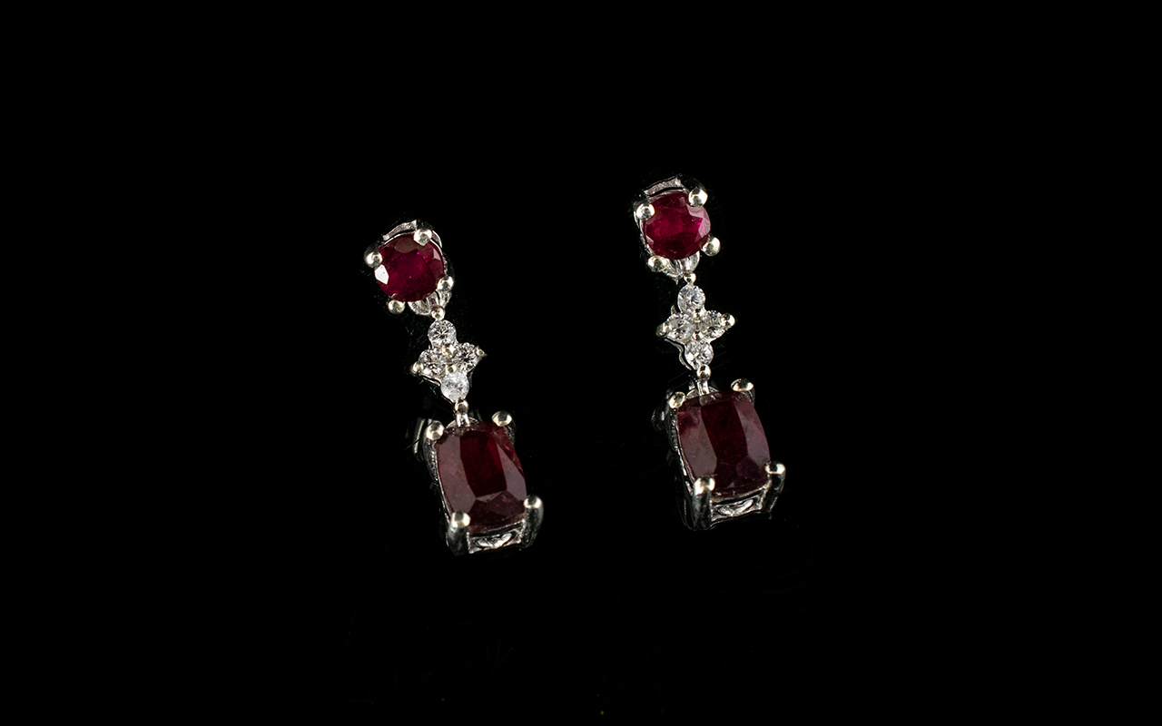Lot 216 - Ruby and Cambodian Zircon Drop Earrings, each earring having a cushion cut ruby, of over 1ct,