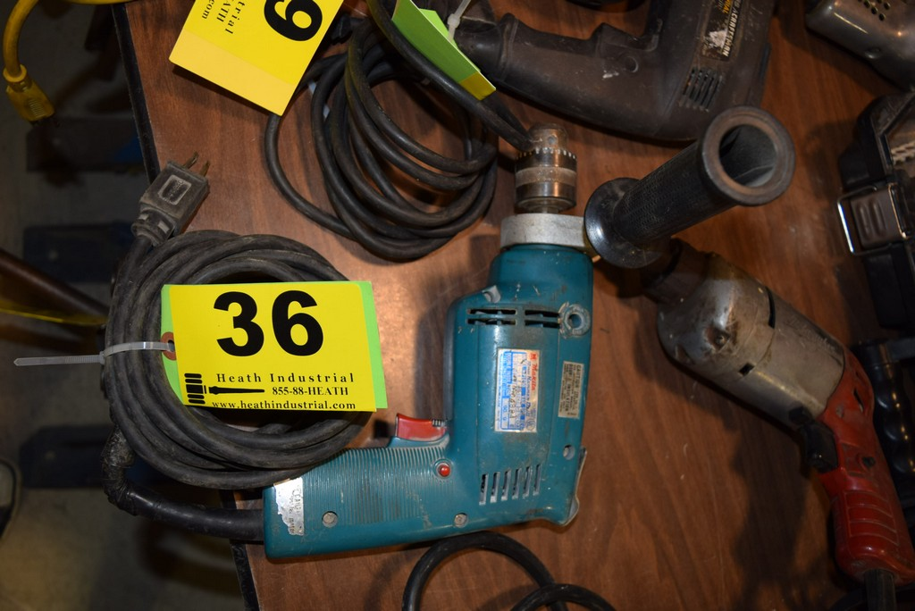Lot 36 - MAKITA MODEL HP1030, 10MM ELECTRIC HAMMER DRILL