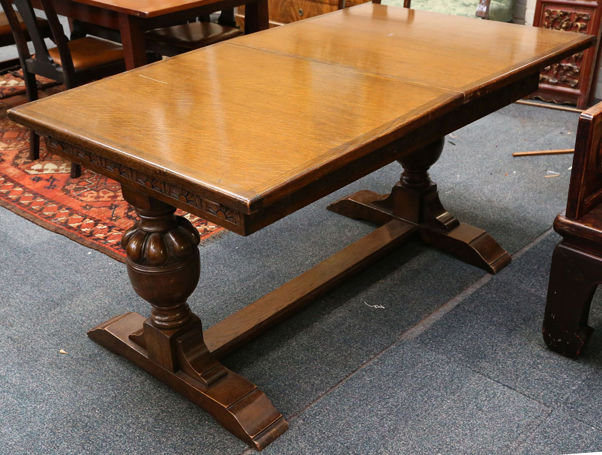 Lot 185 A 1940s Oak Extending Dining Table Blind Carved Supported On Heavy Turned