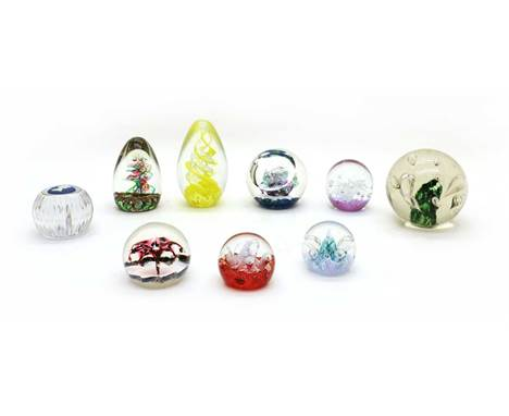 A collection of glass paperweights and dump weights, to include a Caithness limited edition 'Trampoline' example, 'Red Mini M