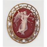 A 14k gold and agate cameo broochSet with an oval layered carnelian plaque finely carved with a
