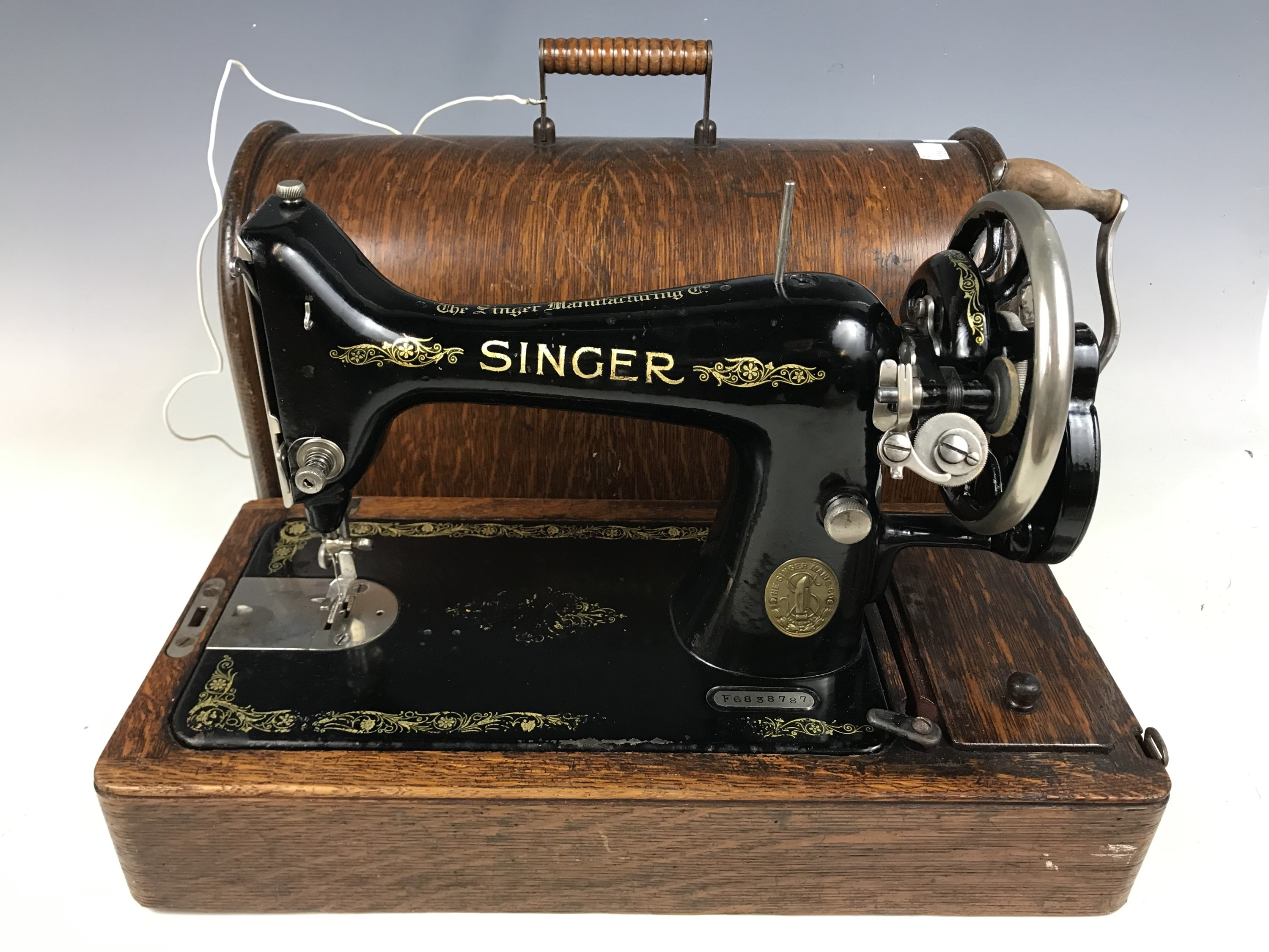 Lot 32 - A cased Singer sewing machine with key