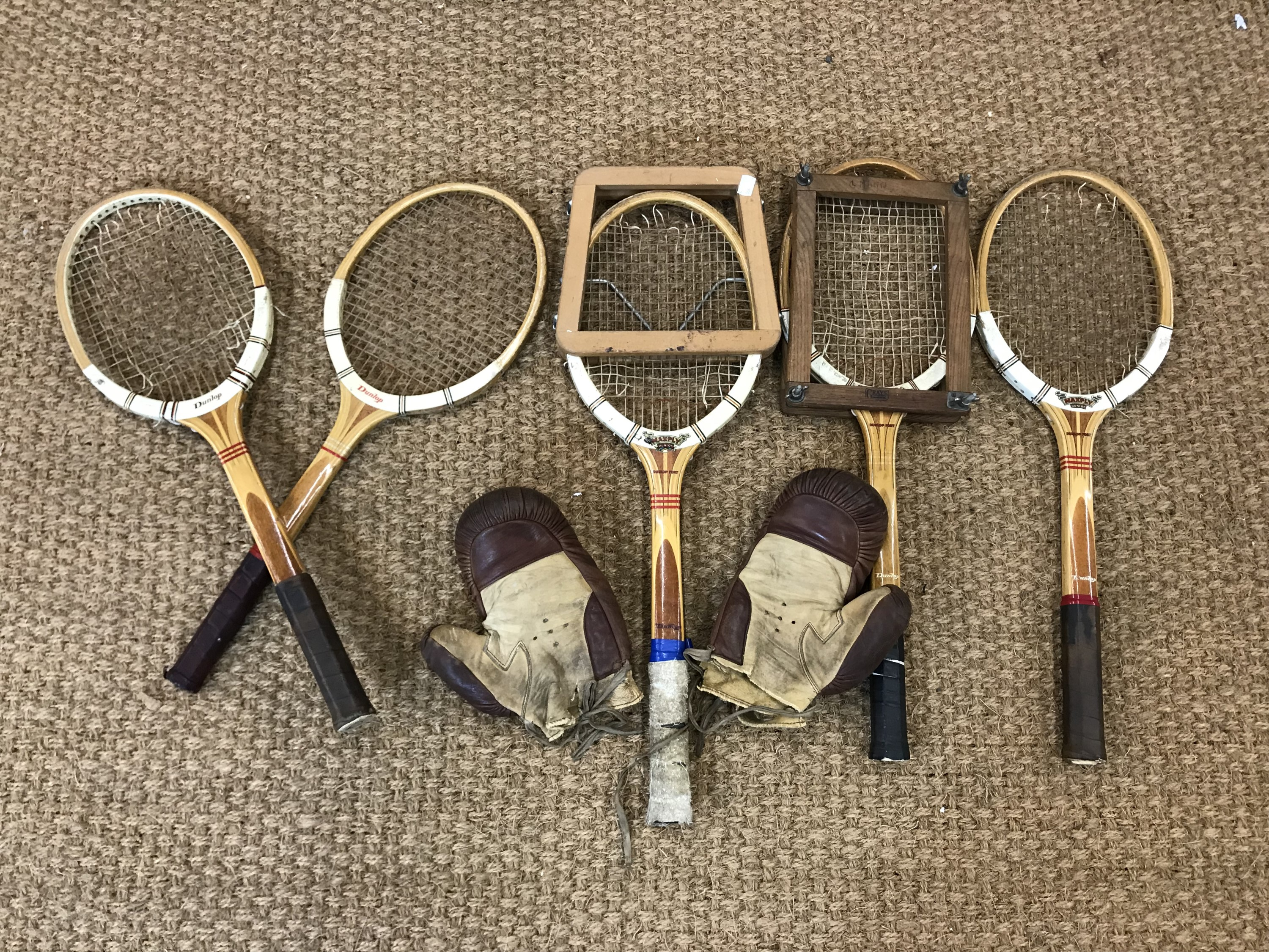 Lot 51 - Vintage Dunlop wooden tennis rackets together with a pair of leather boxing gloves