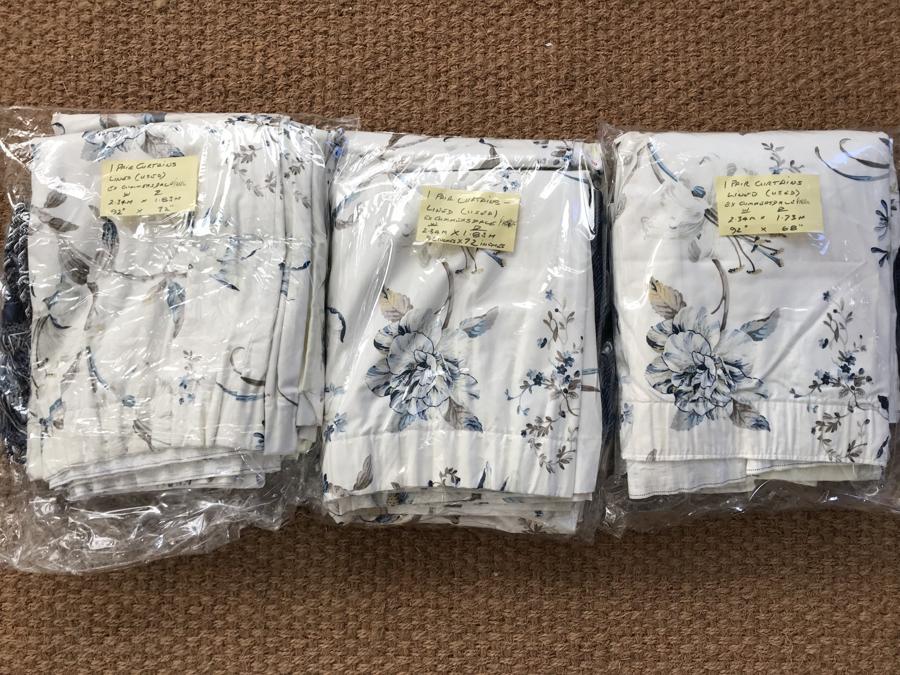 Lot 60 - Three pairs of curtains in Stead McAlpine printed fabric, two x 2.30 m wide x 1.8 m long, one x 2.