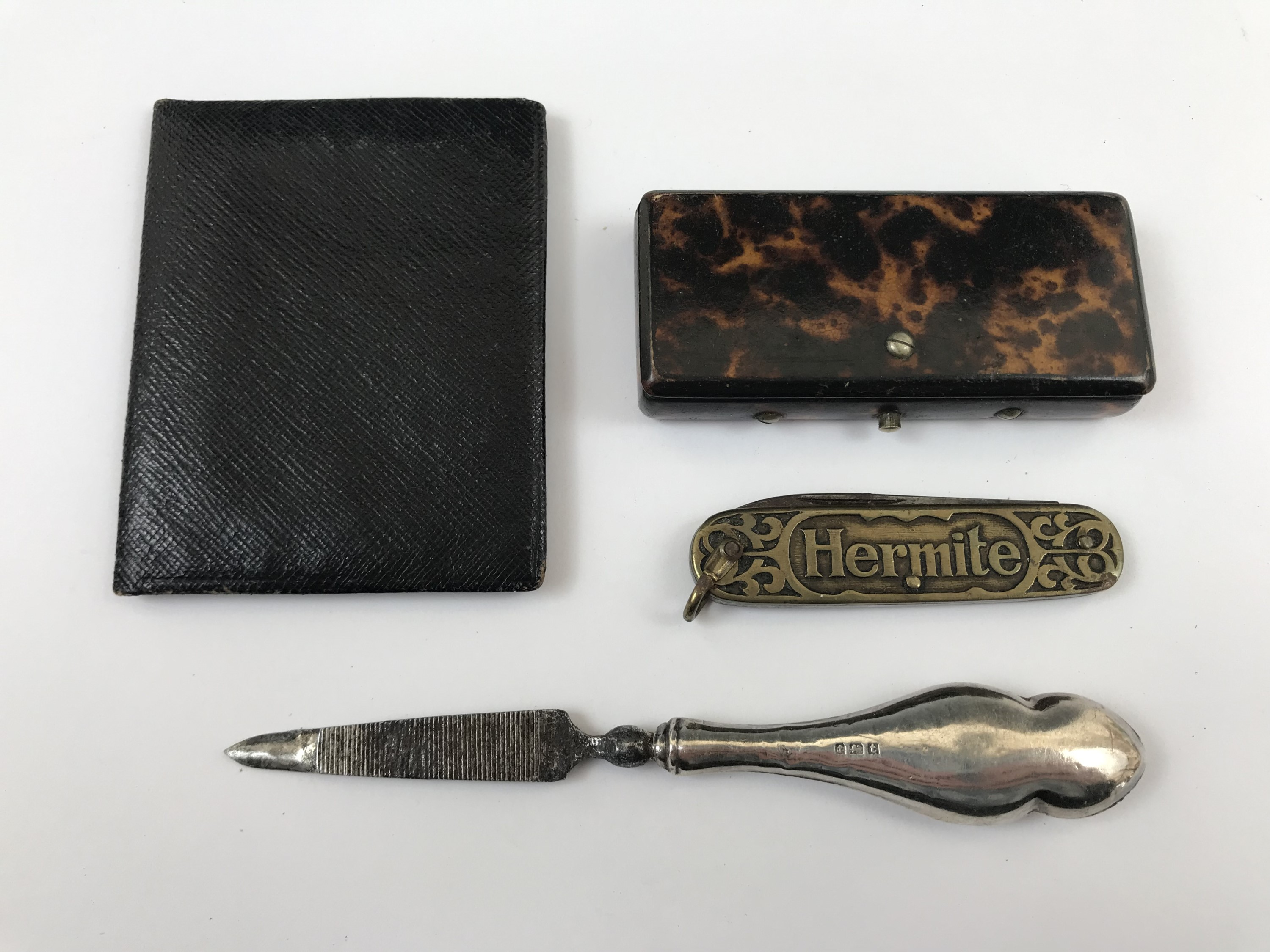 Lot 20 - A 19th Century tortoiseshell vesta case together with a French pocket knife, a silver manicure