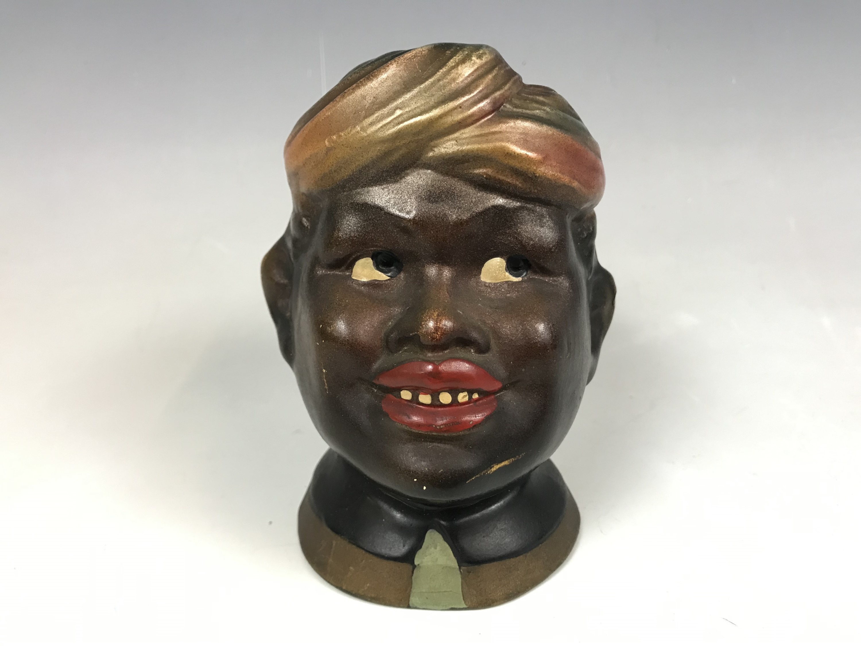 Lot 10 - A 1930s painted plaster money box (a/f)