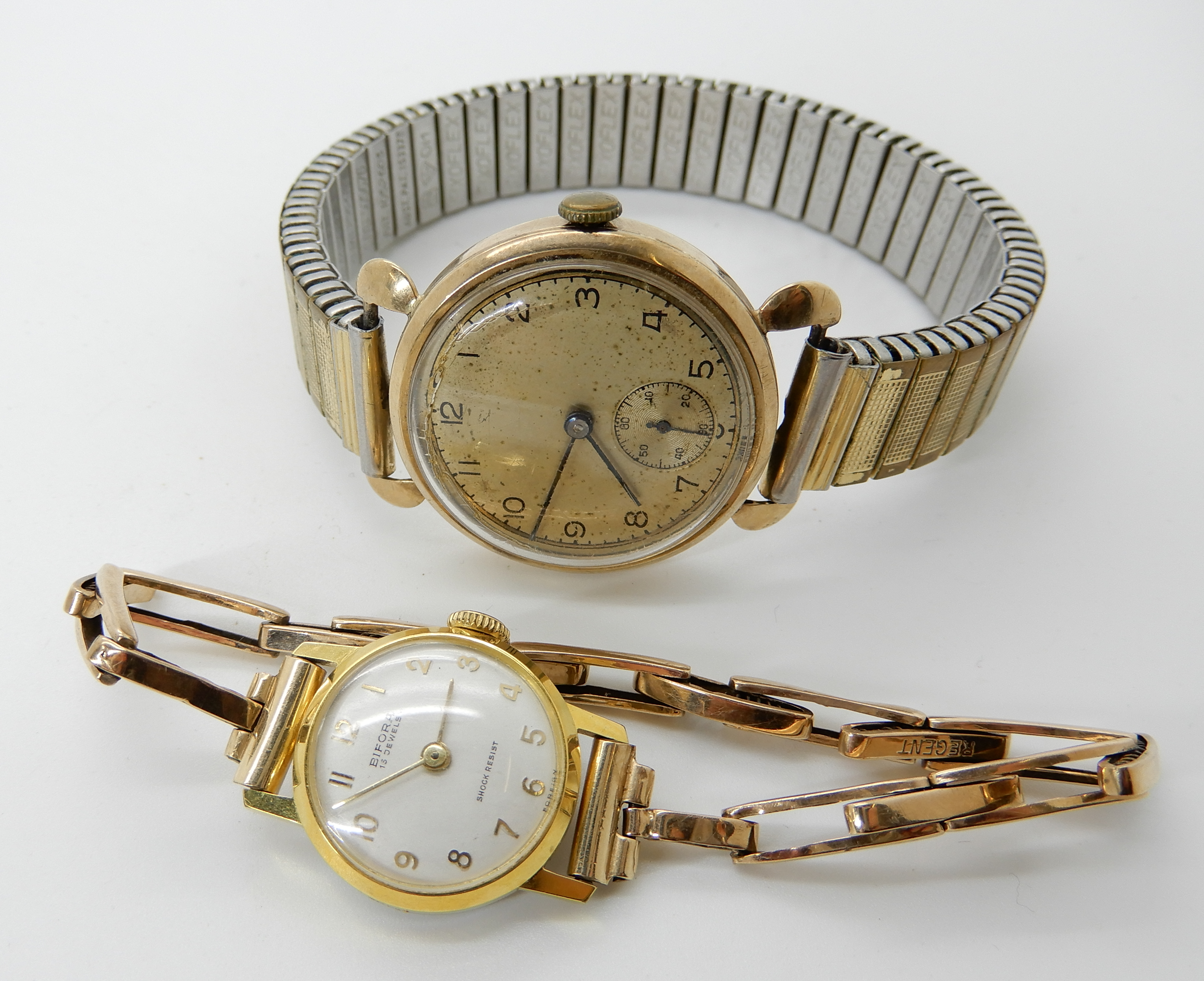 Lot 5 - A 9ct gold gents vintage watch with gold plated strap together with a ladies Bifora watch with 9ct