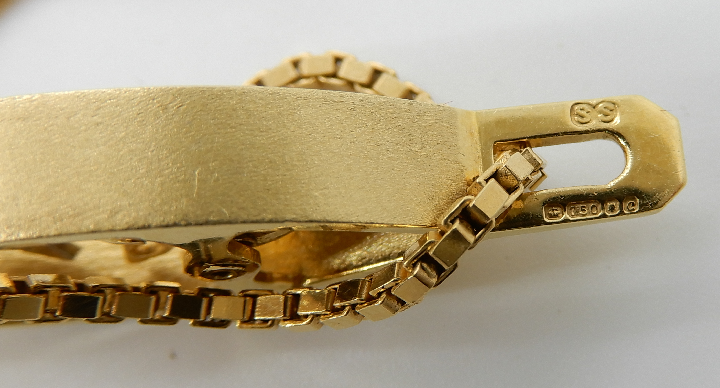 Lot 23 - An 18ct gold retro diamond set flower pendant length 4cm and 18ct box chain length 40cm, weight 16.