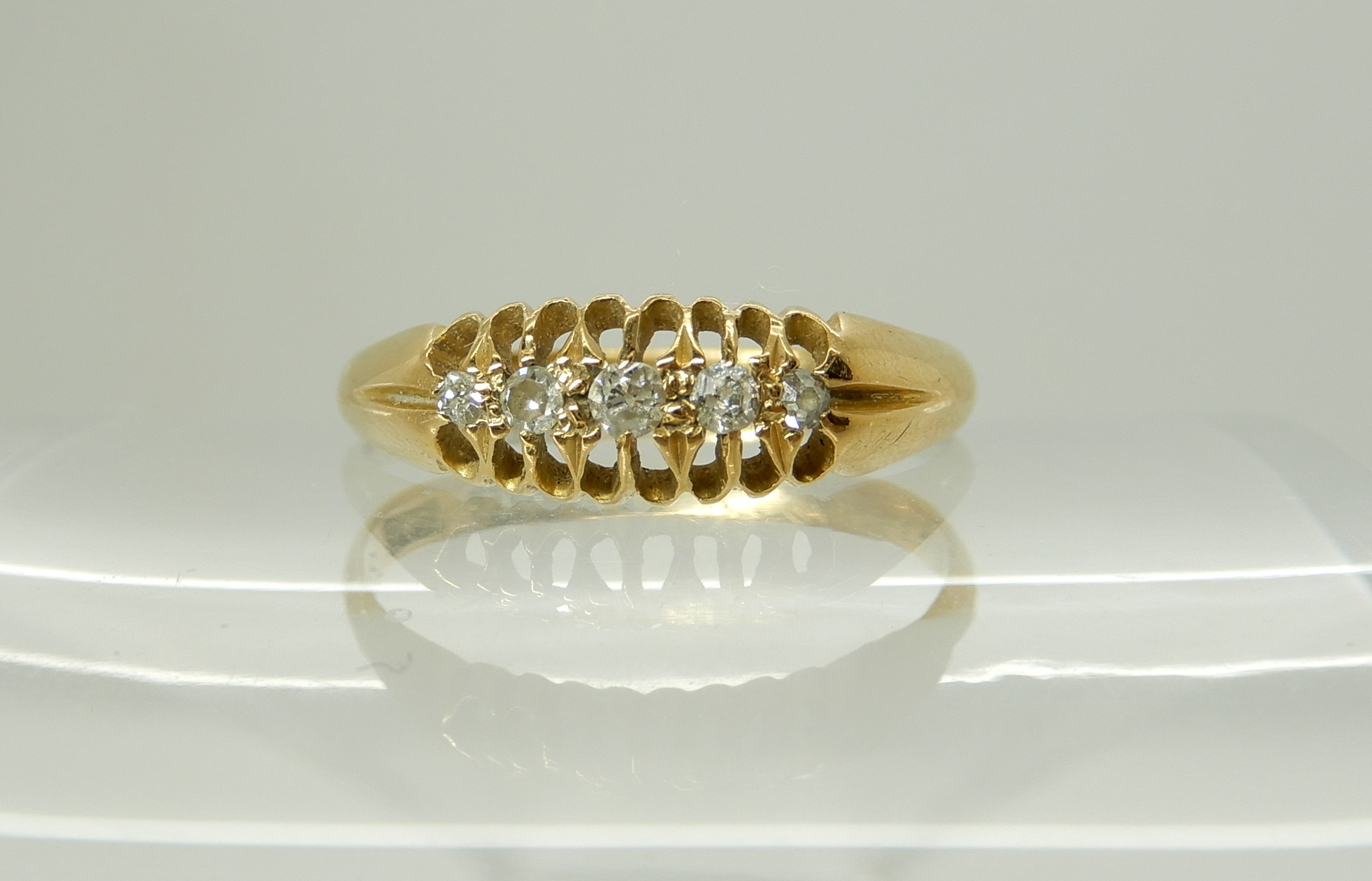 Lot 16 - An 18ct gold five stone diamond ring, size P, weight 2.4gms Condition Report: Available upon
