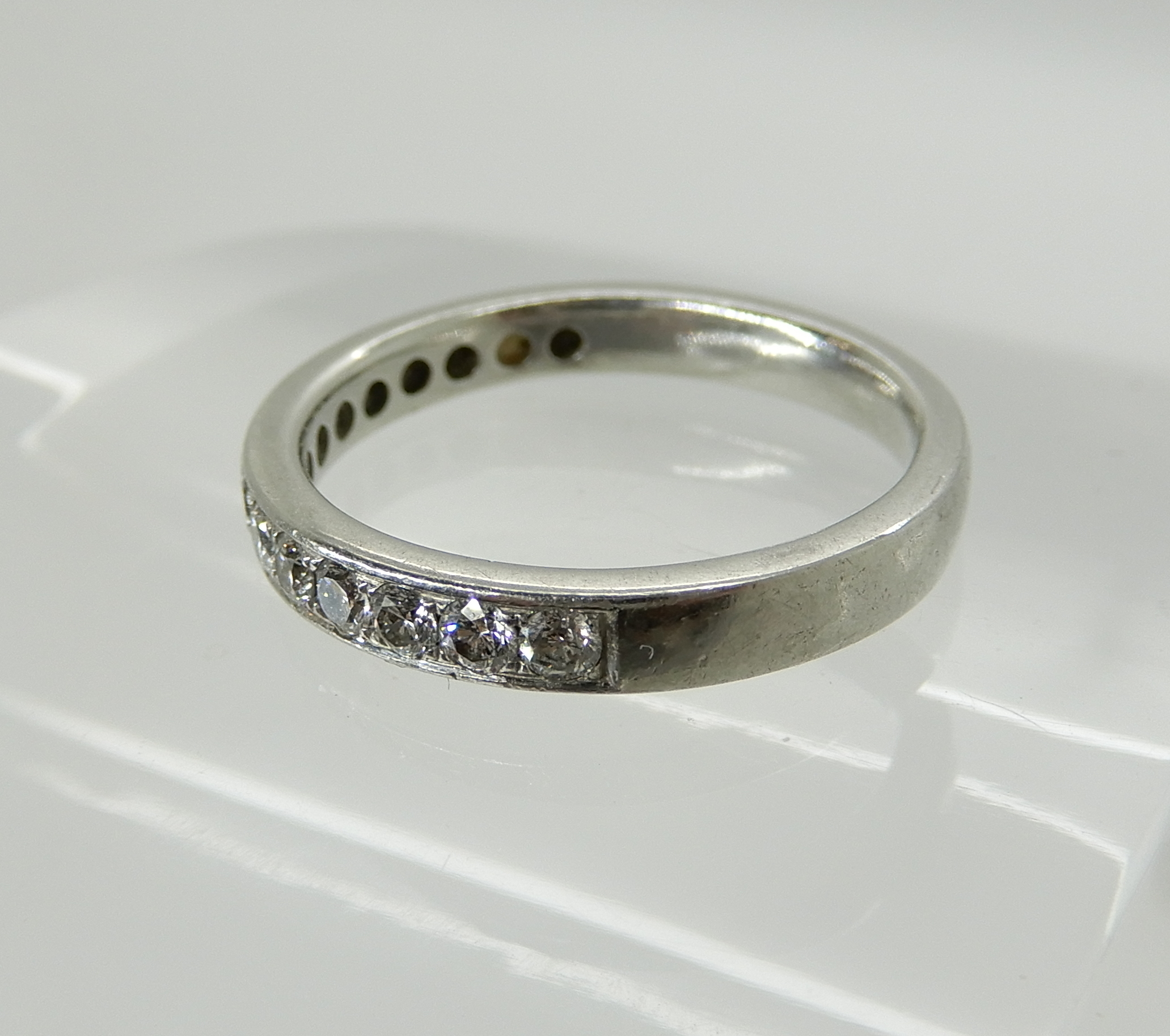Lot 4 - A Chisholm Hunter platinum diamond set half eternity ring, estimated approx diamond content 0.25cts,