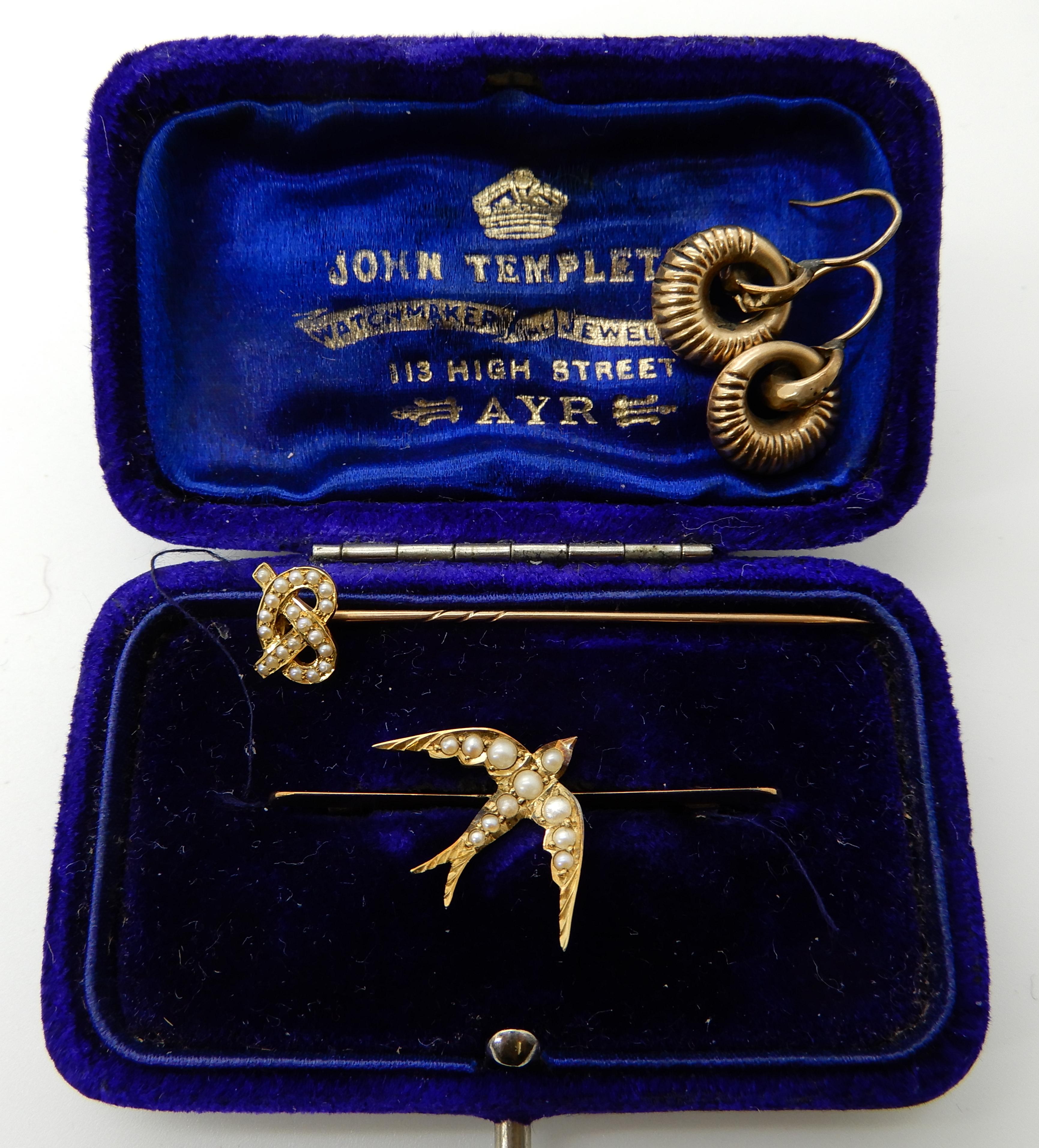 Lot 47 - A bright yellow metal pearl set swallow brooch, a bright yellow metal pearl set lovers knot pin
