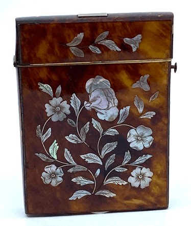 Lot 192 - Edwardian card case clad in tortoiseshell and decorated to both sides in inlaid mother of pearl with