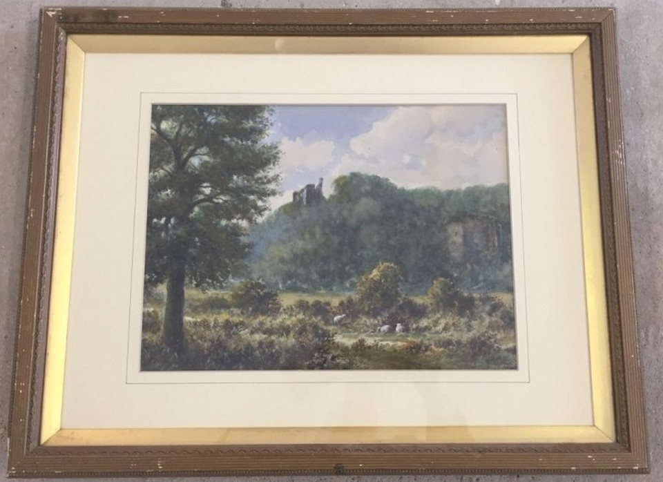 Lot 137 - Signed watercolour landscape, with ruined castle atop a hill, with sheep grazing below.