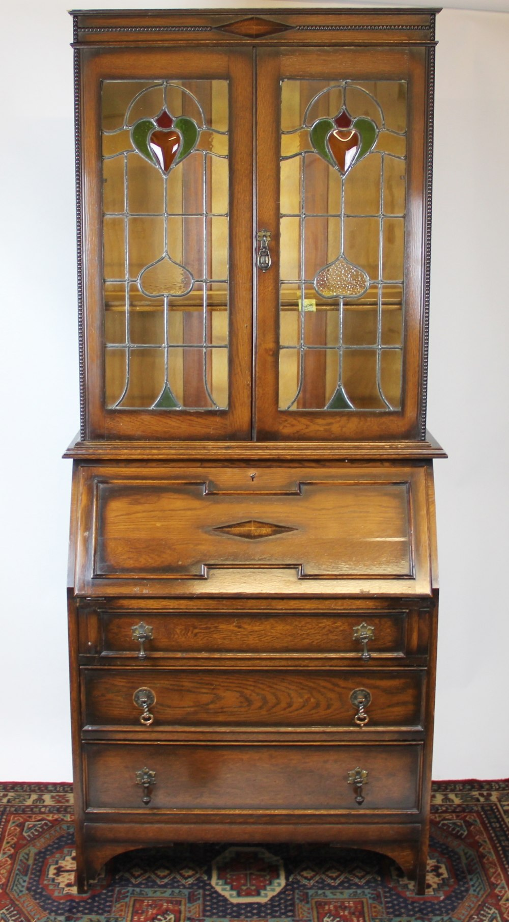 An Edwardian mahogany bureau bookcase, with two Art Nouveau stained ...