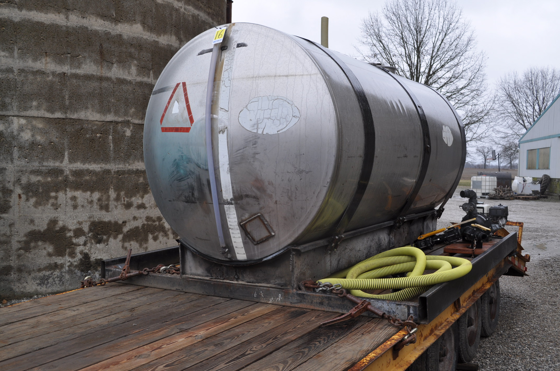 "1400 gal SS tank on steel skid with 2"" banjo poly pump, Honda engine"