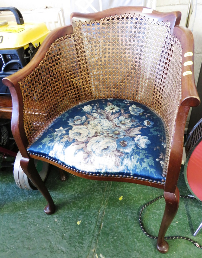Lot 48 - MAHOGANY FRAMED CANE BACK TUB CHAIR WITH FOLIATE UPHOLSTERED SEAT