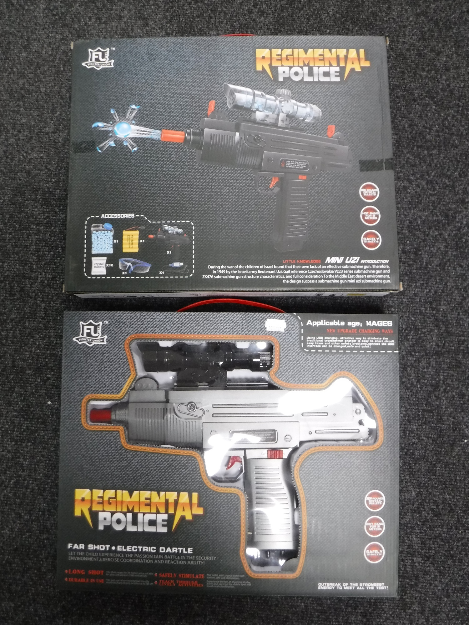 Two boxed of regimental Police mini Uzi electric water