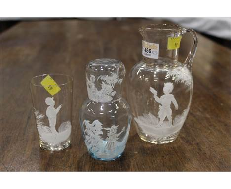 Three pieces of Mary Gregory style glassware, jug, beaker and carafe and glass