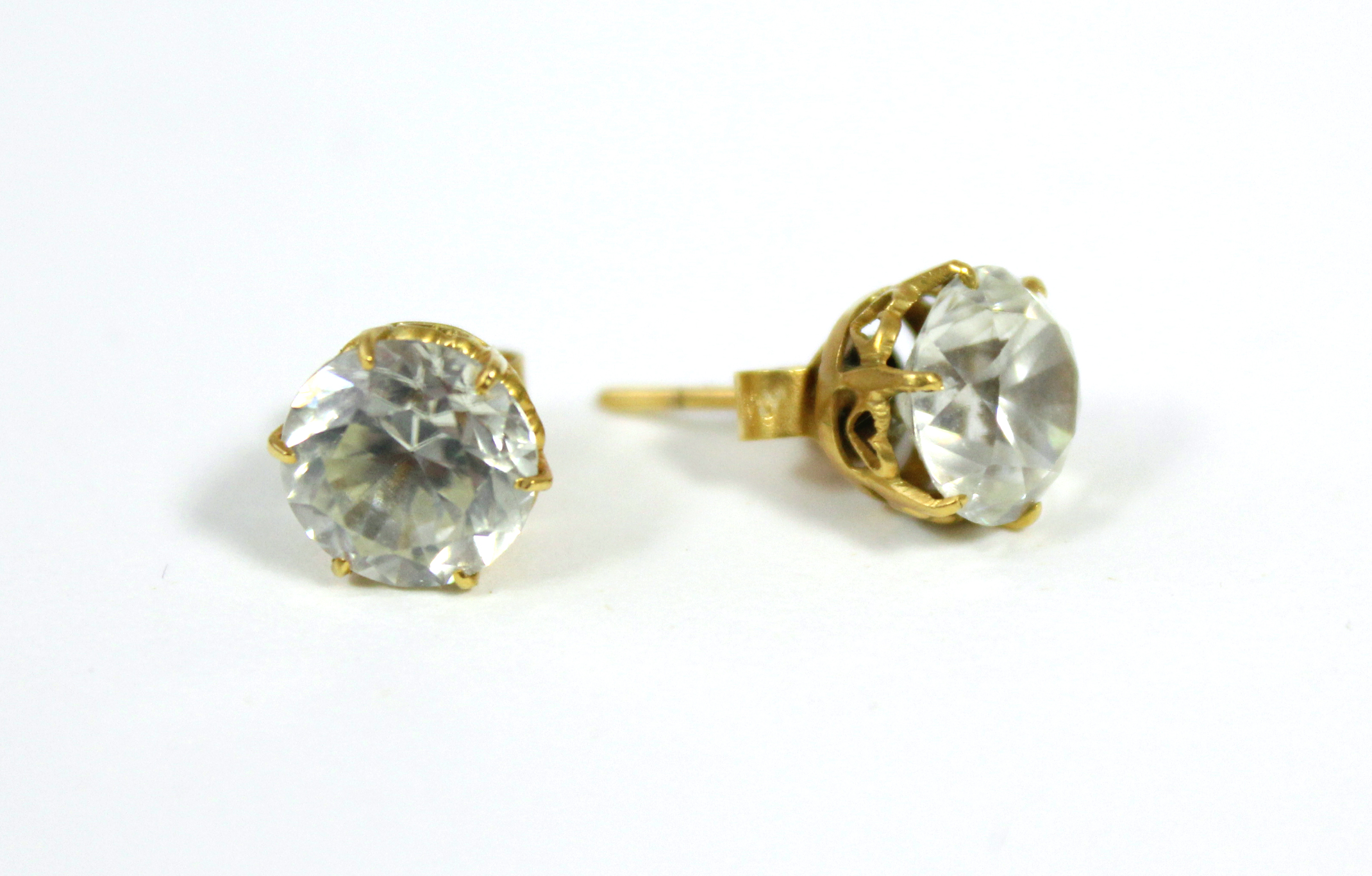 A pair of white topaz ear studs.