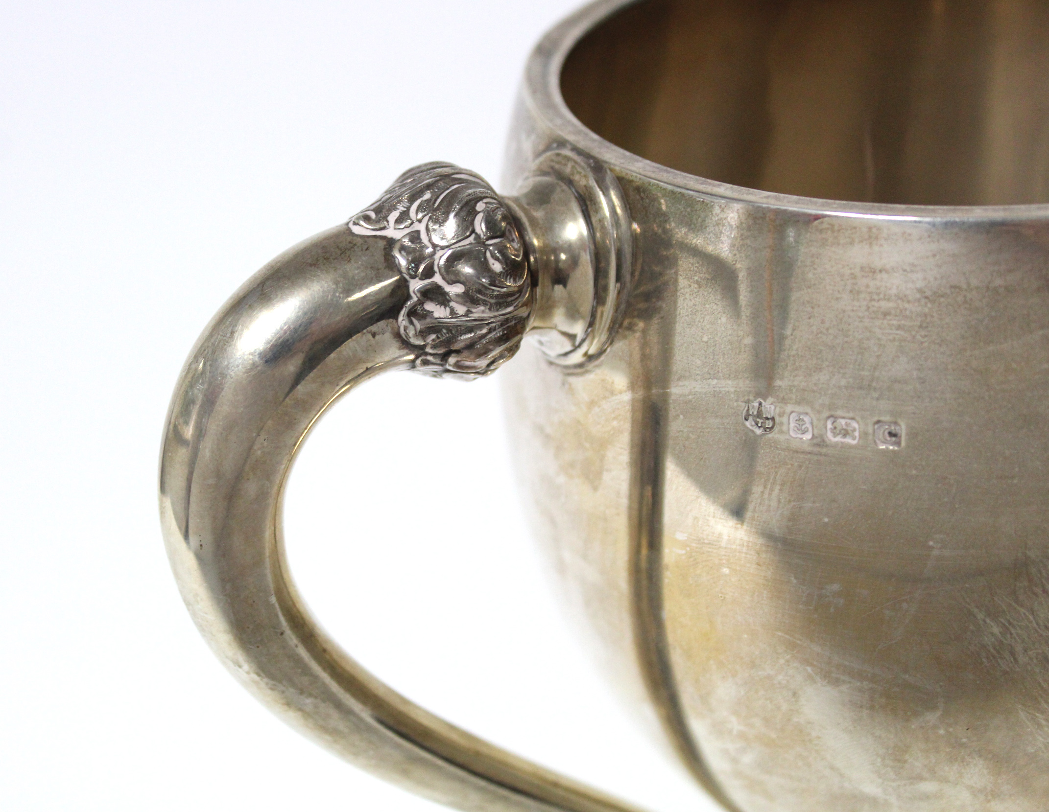 Lot 11 - A George V large two-handled trophy cup of ovoid shape, with foliate side handles & on circular