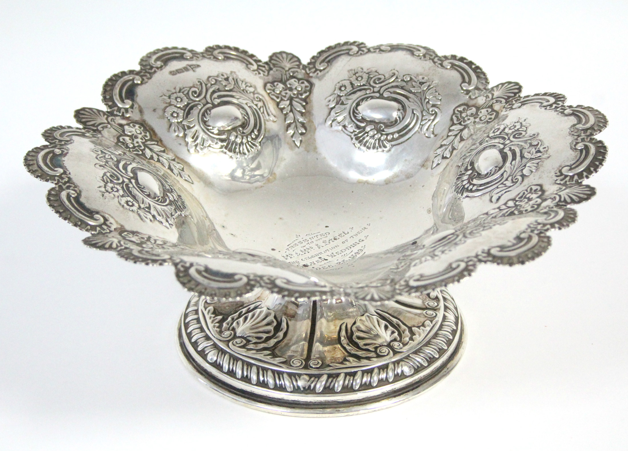 Lot 30 - A late Victorian silver embossed sweetmeat dish of lobed circular form with scalloped-edge &