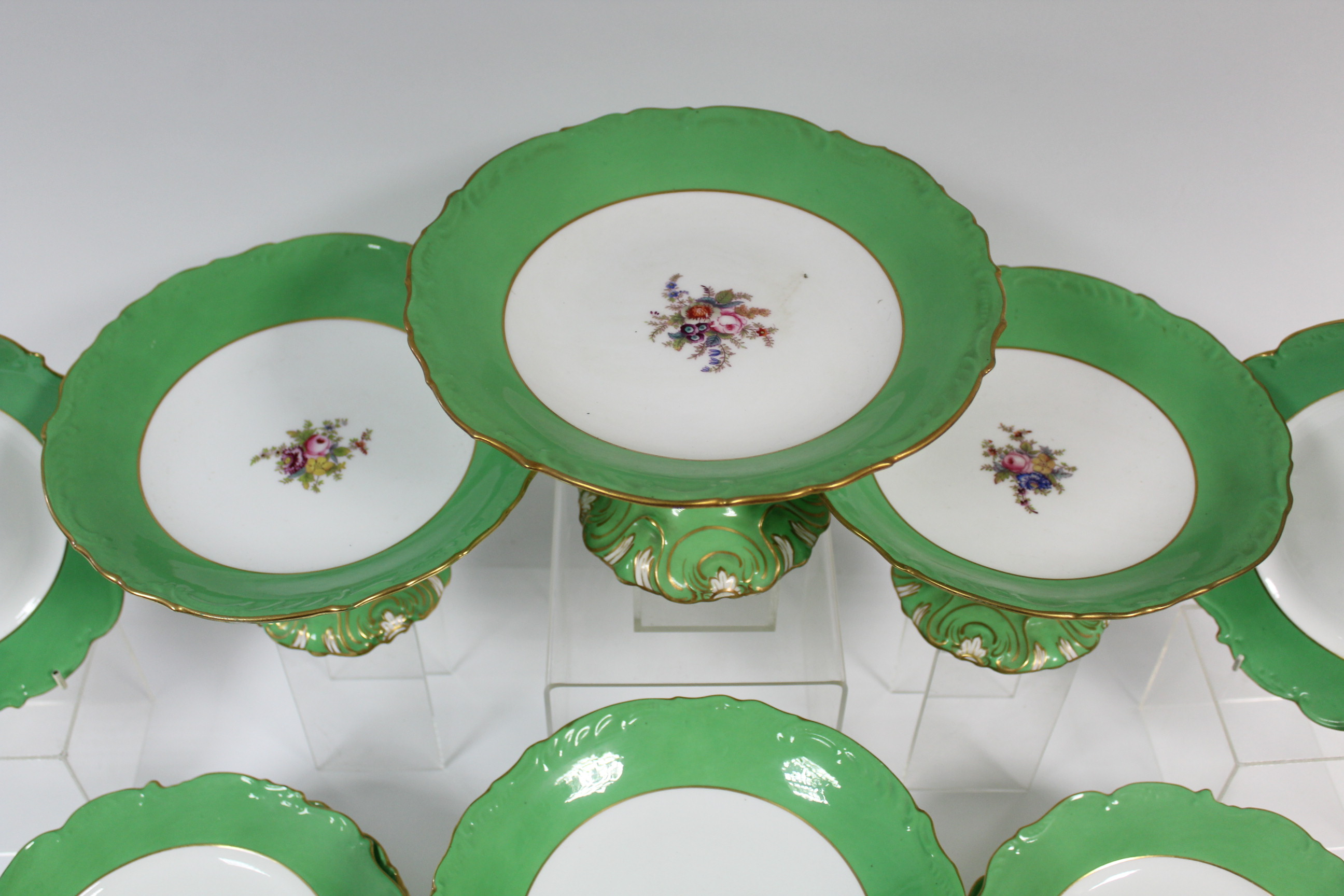 A Coalport porcelain dessert service with wide apple-green borders & moulded gilt rims, each piece - Image 2 of 3