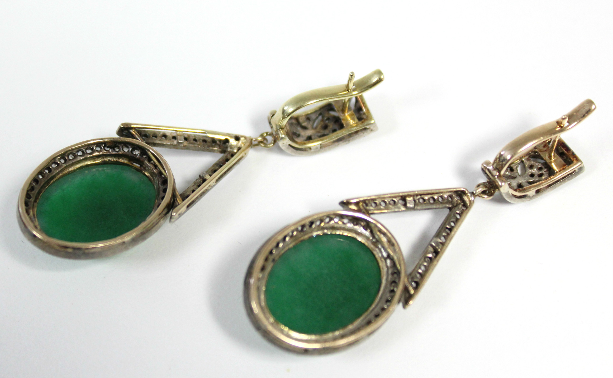 A PAIR OF JADE & DIAMOND PENDANT EARRINGS, each with oval green jade cabochon suspended from an - Image 6 of 6