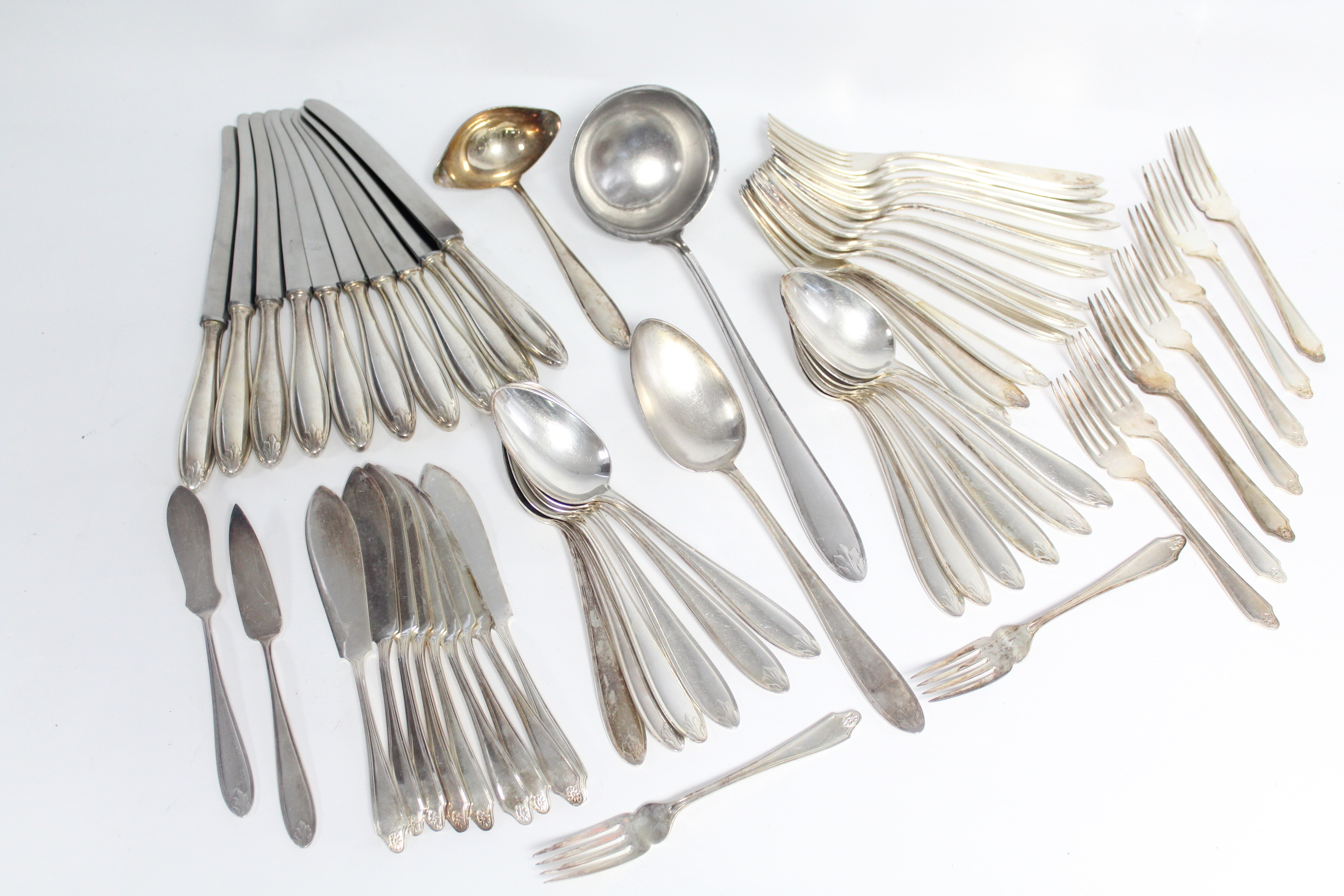 Lot 6 - A part-service of WMF flatware & cutlery with leaf terminals, comprising: twelve table spoons;